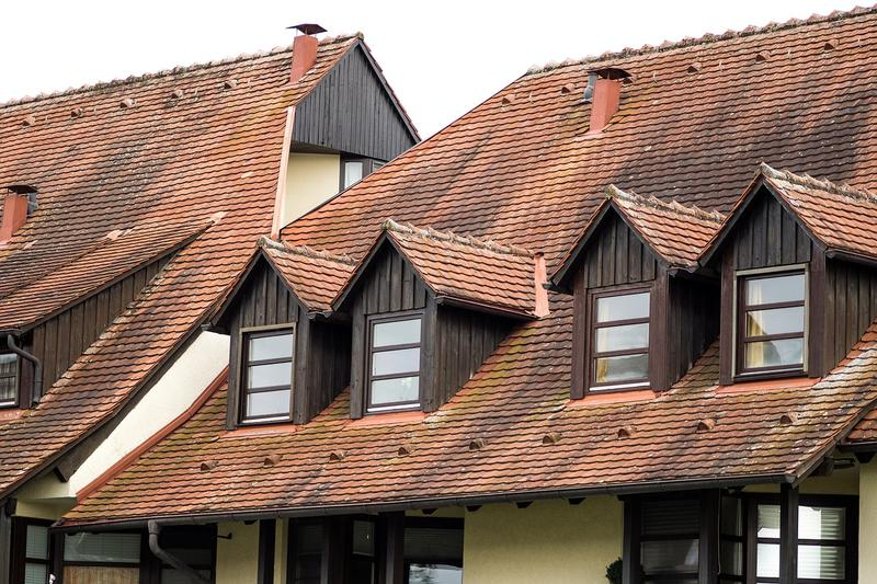 What can cause a home to need new roofing installation?