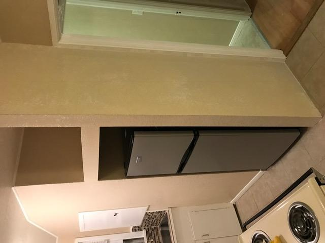 Refrigerator enclosure