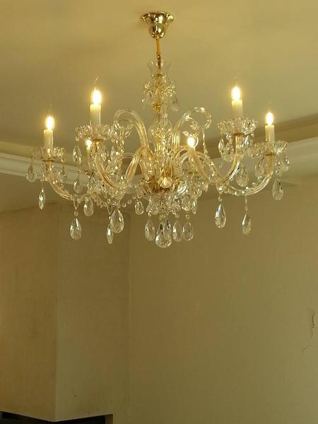 The Neo-Classic chandelier 8 lamps Chandelier with genuine crystal.
