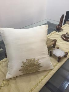 Crisp White Color Cushion With Embroidered Gold Design